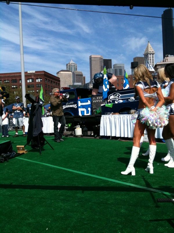 Tailgate Warriors with Guy Fieri and Seattle Seahawks Seagals on the shows field turf set.