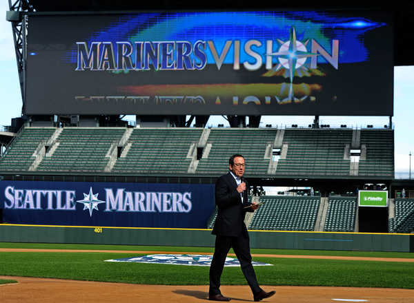 Kevin Martinez, the Mariners' vice president of marketing, shows off the new MarinersVision scoreboard.