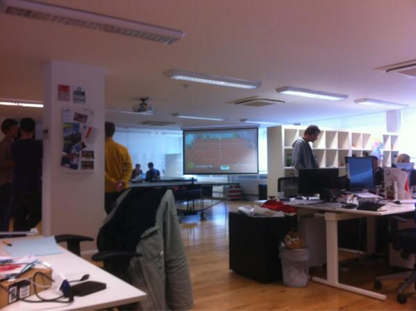"The ""Tweet and Shoot"" event live on a big screen at the We Are Social Paris office"