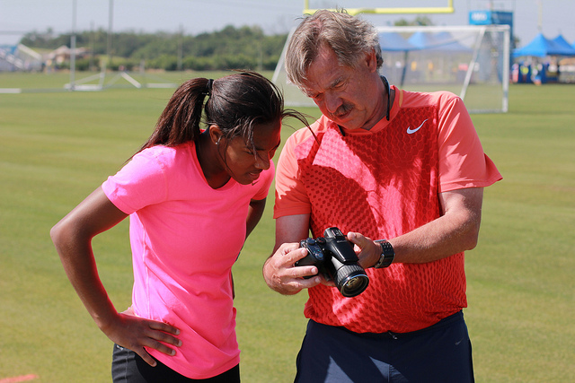 World-renowned track and field coach Loren Seagrave, IMG Academy's current Director of Speed and Movement, will serve as Director of Track & Field and Cross Country, gives instant digital feedback to an athlete while she trains