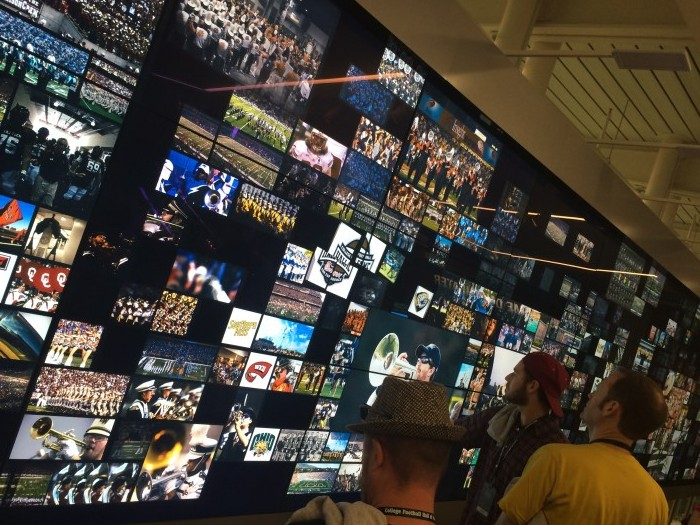 A multi-touch system allows for interaction with content specific to a fan's favorite college football team.
