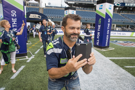 "American Express And Seattle Seahawks Host ""Dinner on the 50"" on CenturyLink Field - SportsTechie blog, image via Mat Heyward / Getty Images for American Express."