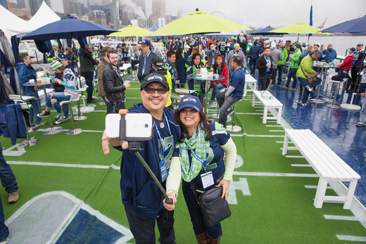 In partnership with the Seahawks, AMEX is breaking out a 200 foot barge moored on Pier 66 on the Puget Sound.