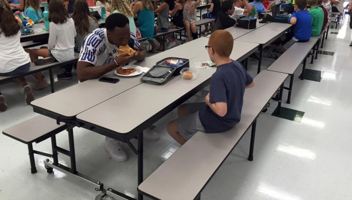 ACC Now shared the picture and story that went gone viral regarding FSU player Travis Rudolph eating a piece of pizza with middle schooler Bo Paske during a team visit, image via Leah Paske on Facebook.